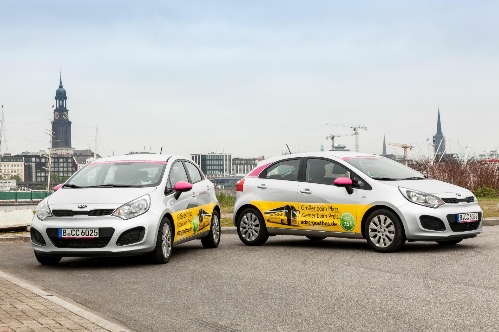 CiteeCars mit Werbung der Deutschen Post AG