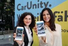 Opel-Marketingchefin Müller und Kampagnenbotschafterin Zimmermann präsentieren die CarUnity-App